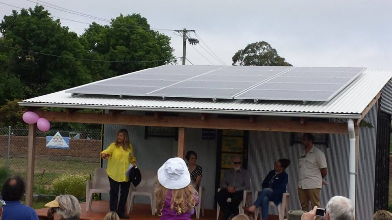 Moss Vale community garden members with off-grid solar installation