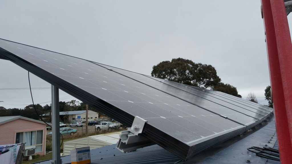 Solar panels on Albert's landlord-tenant joint project roof